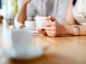 Close-up hands holding mug