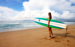 Surfer looking at ocean
